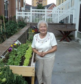 Pat Gaston enjoys the pine street garden
